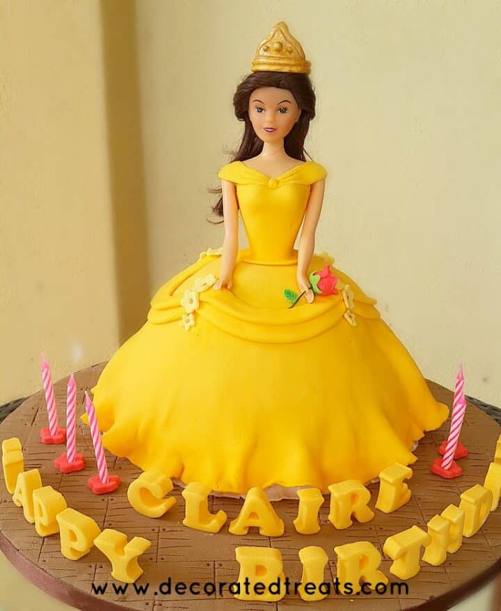A Belle cake with cake lettering on the cake board