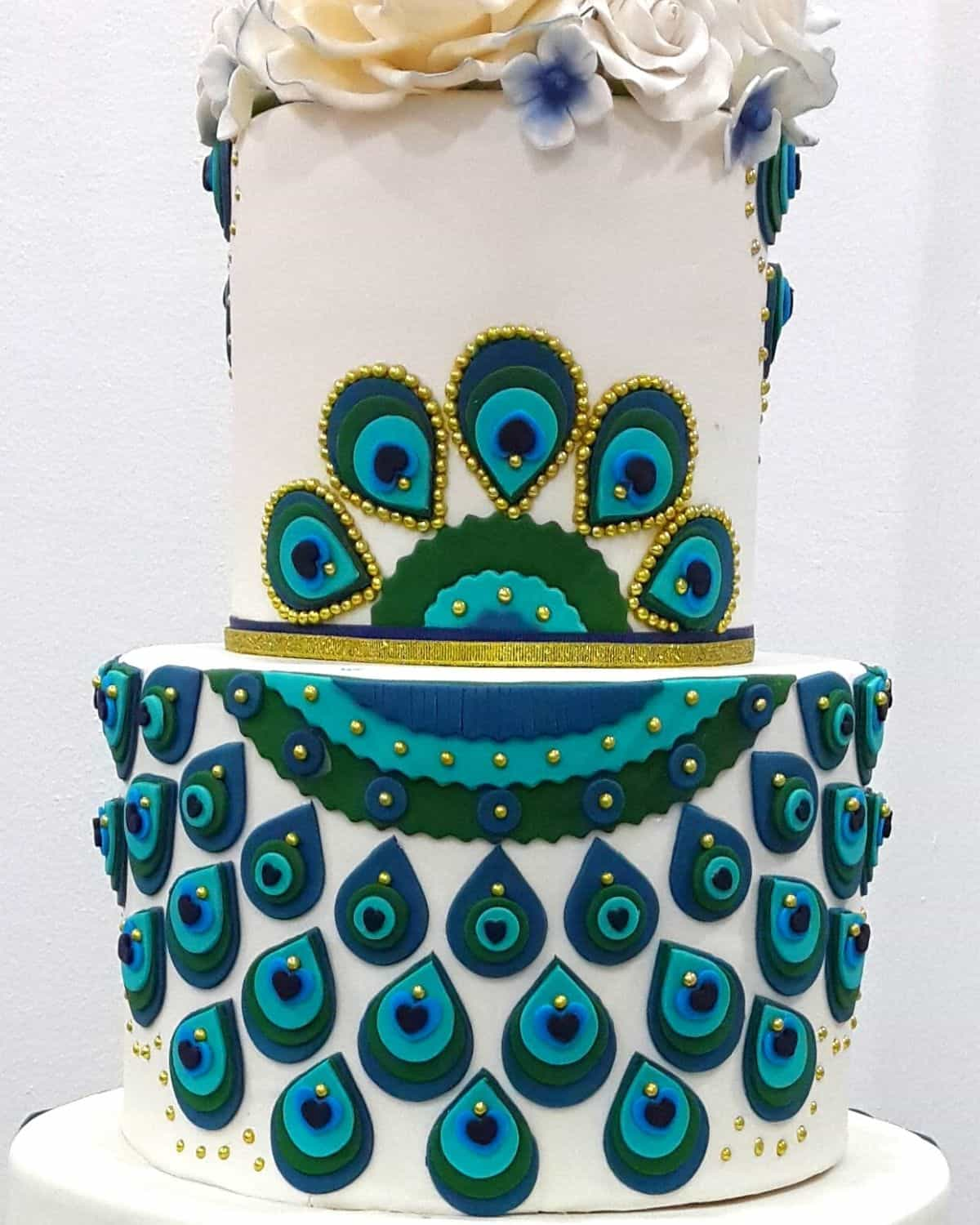A peacock inspired tiered cake