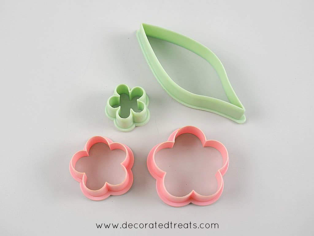 3 flower cutters in different sizes and one leaf cutter