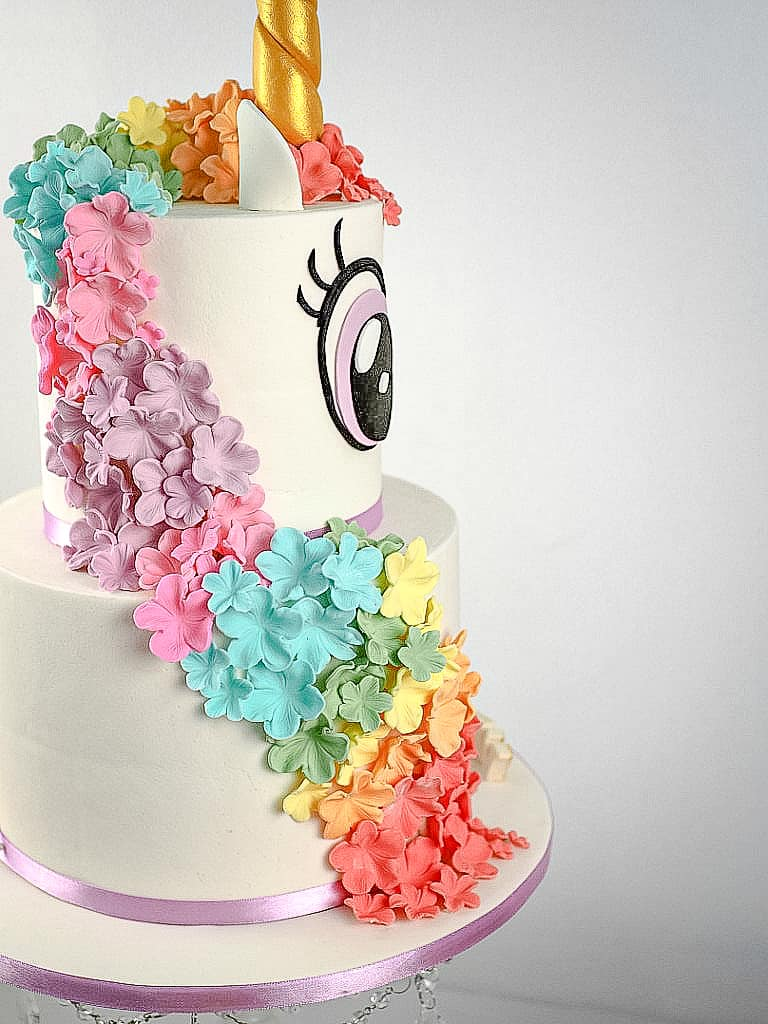 Colorful sugar flowers on a unicorn cake