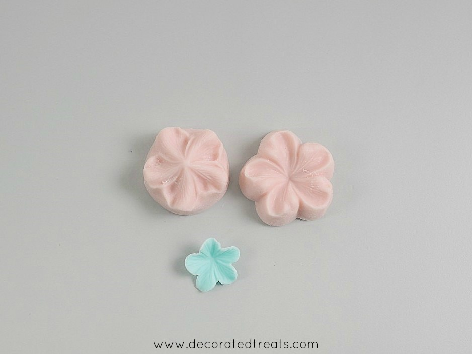 A 5 petal blue fondant flower cut out with sugar blossom silicone molds