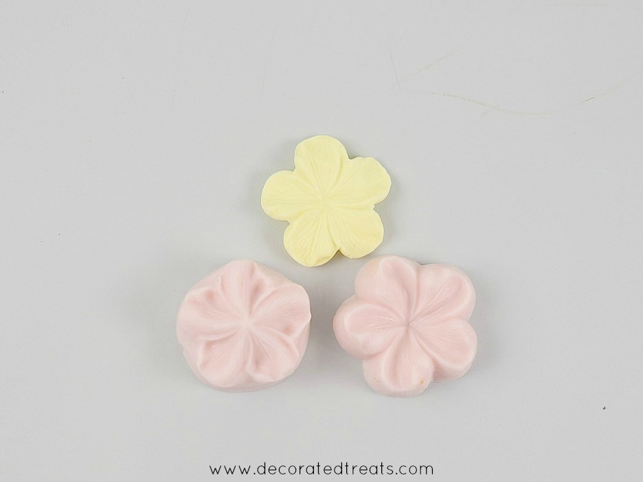 A 5 petal yellow fondant flower cut out with sugar blossom silicone molds