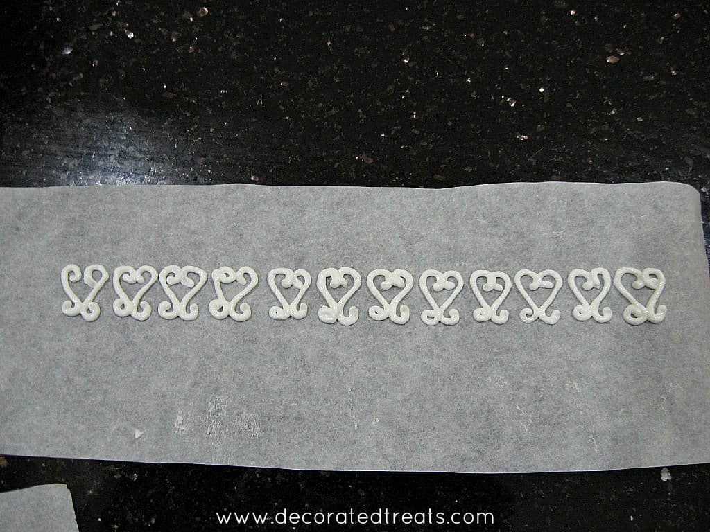 Filigree icing on parchment paper