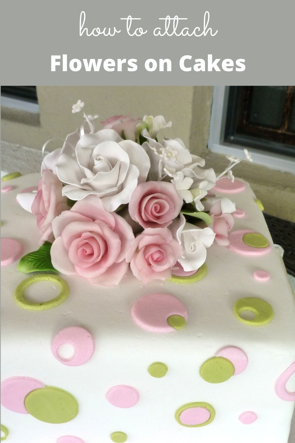 Pink and white flowers topped square cake