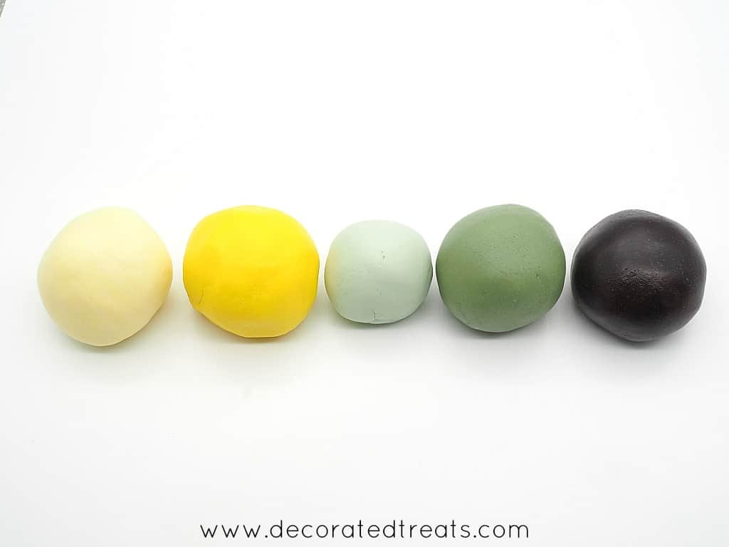 Fondant balls in beige, yellow, light green, green and brown
