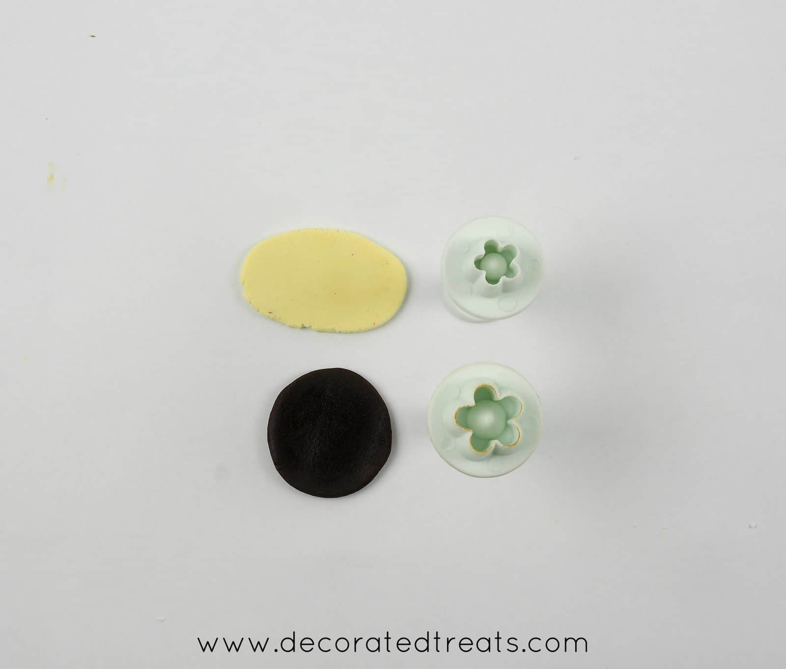 2 flower plunger cutters, some brown and yellow fondant