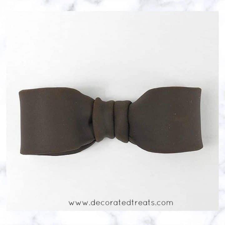 Brown fondant bow
