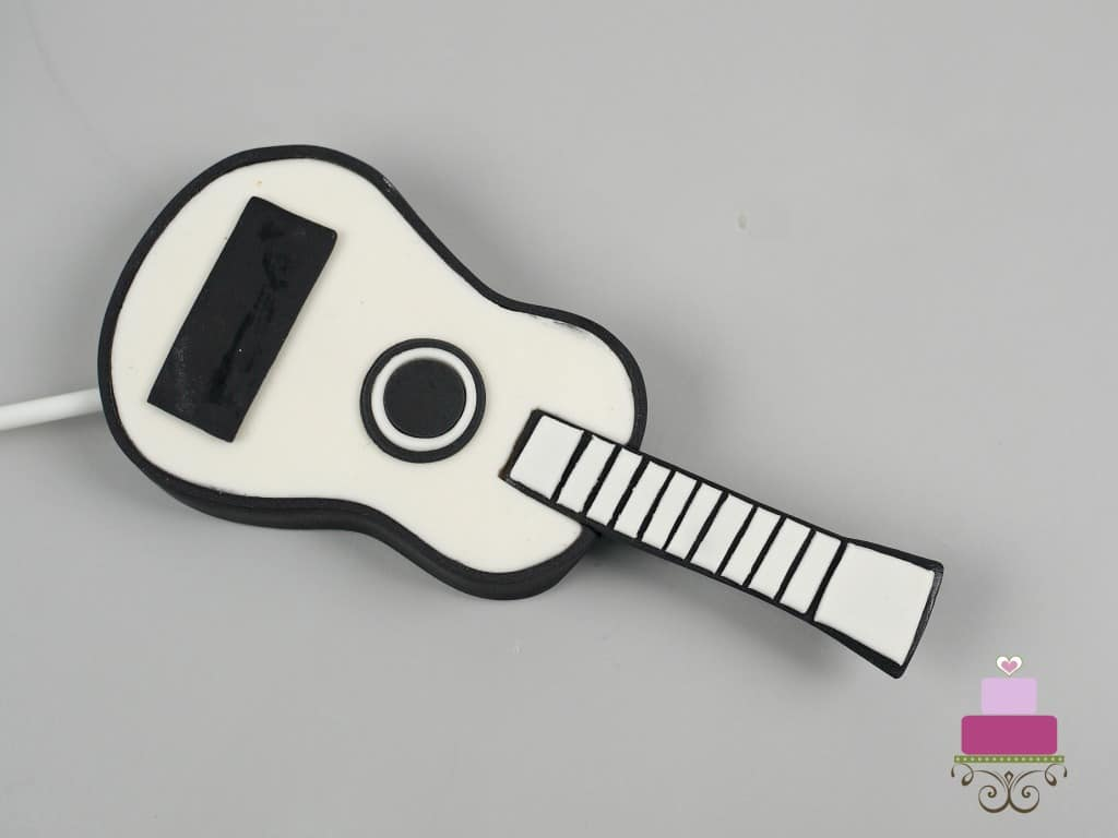 Fondant guitar against a grey background
