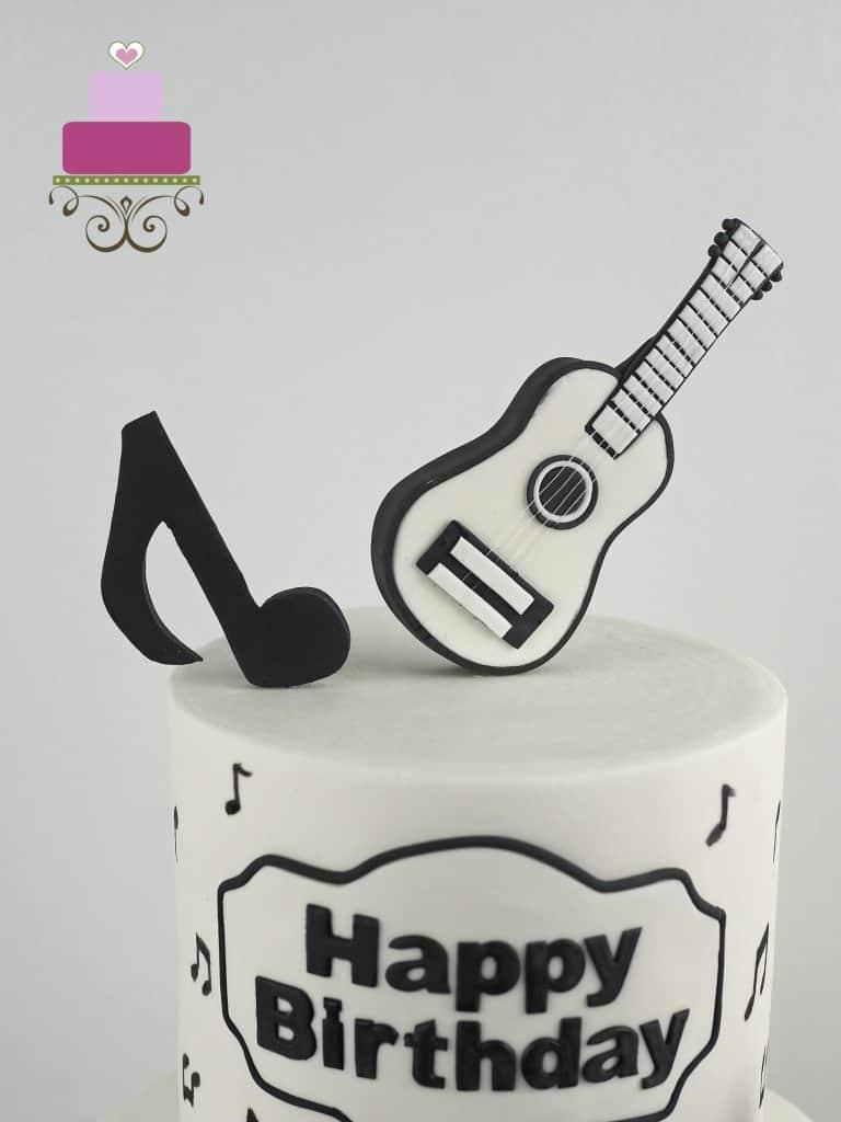 Black and white guitar cake topper