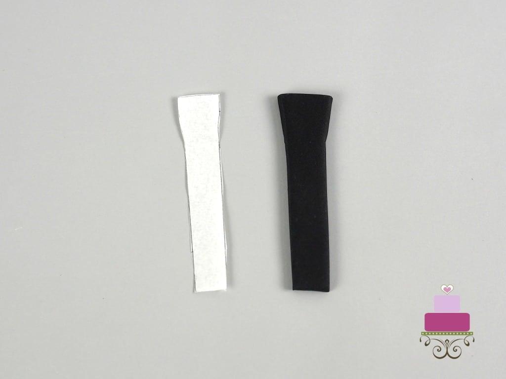 A black and a white strip of fondant