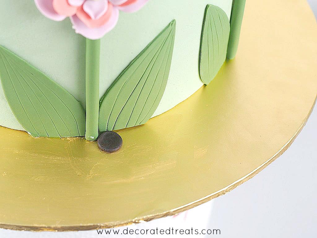 A small, flat piece of brown fondant on a cake board