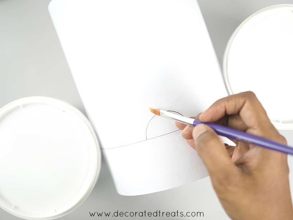 Brushing a paper template by hand
