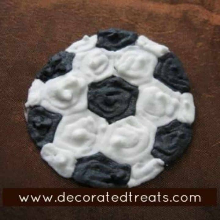 Royal icing soccer ball on a brown backgroud