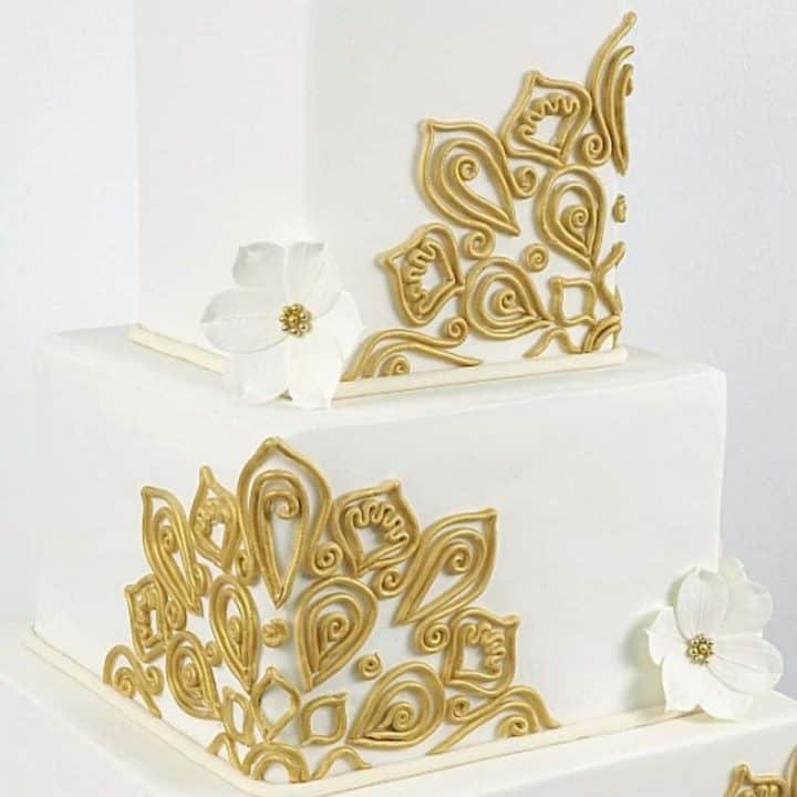 3 tier square wedding cake with gold fondant lace