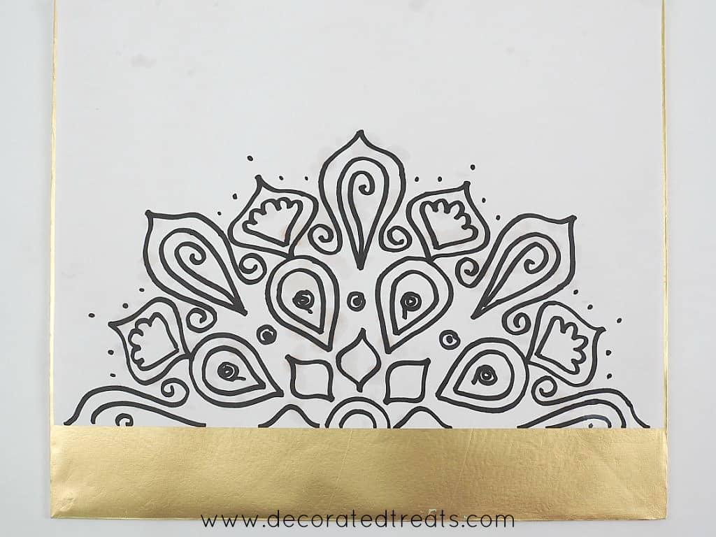 Fondant lace template on a gold cake board