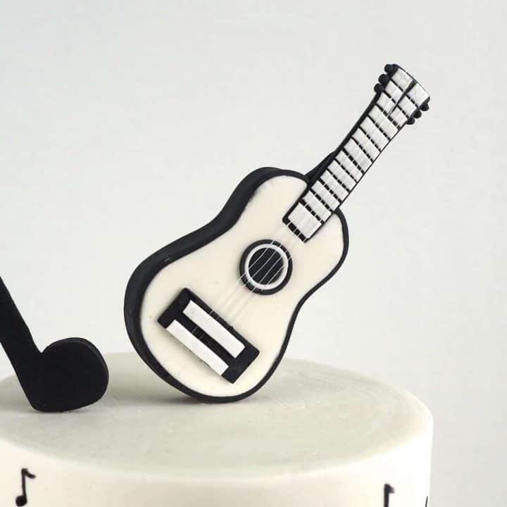 Black and white guitar cake topper