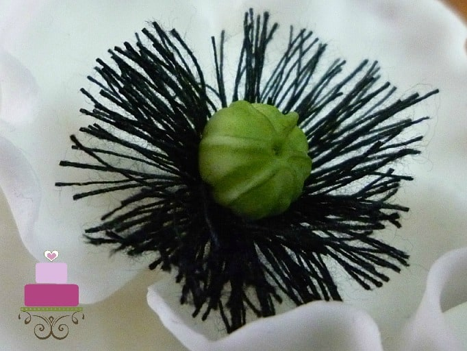 Black thread and green gum paste center for a gum paste poppy