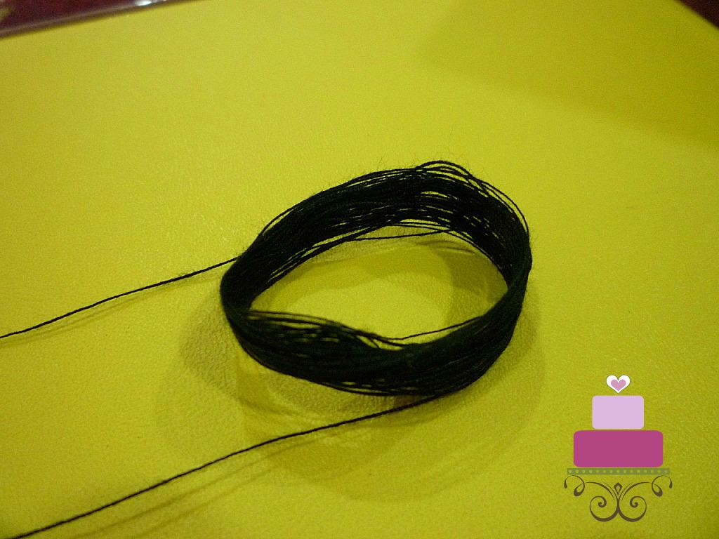 Loops of black thread