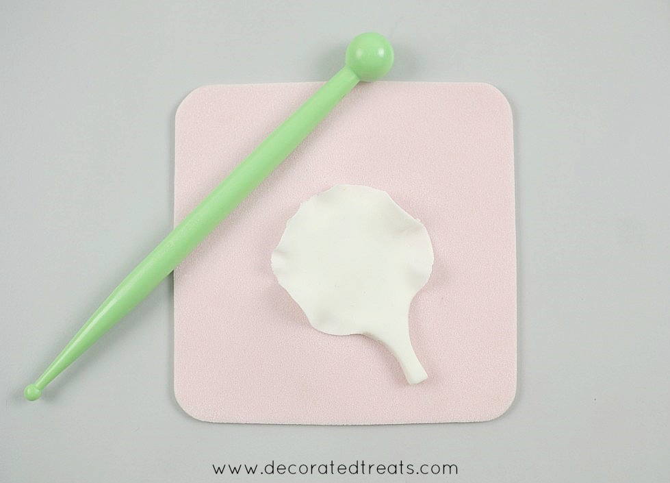 Using a ball tool to shape a gum paste petal