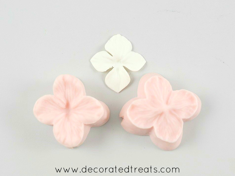 Silicone hydrangea formers with a gum paste hydrangea flower in the background
