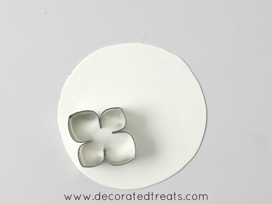 Hydrangea flower cutter on a piece of rolled gum paste