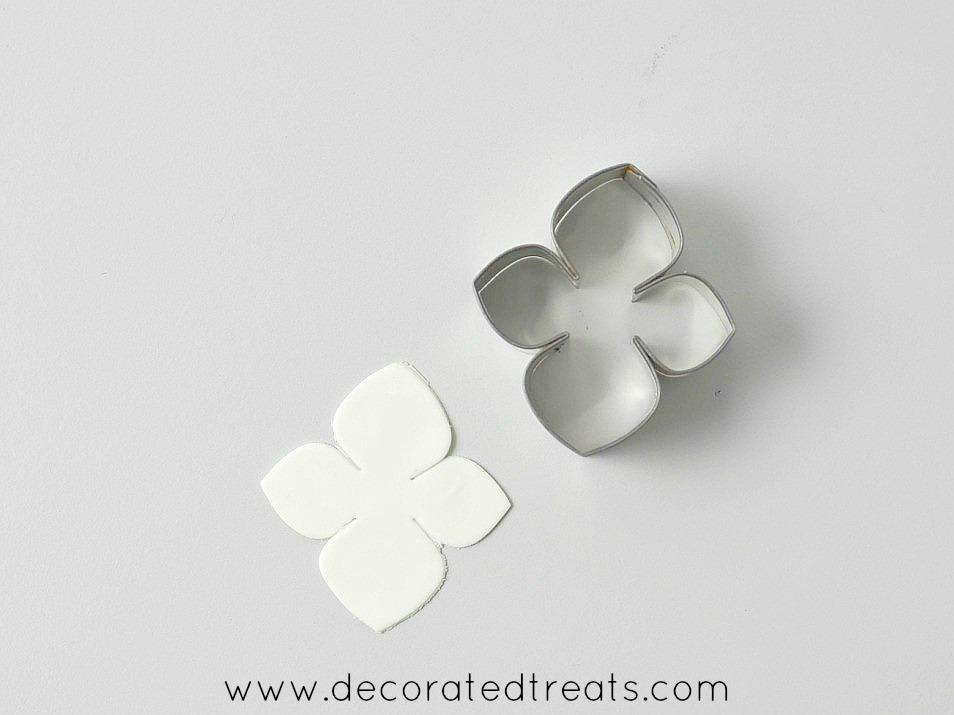 Hydrangea petal cutter with a gum paste petal cut out