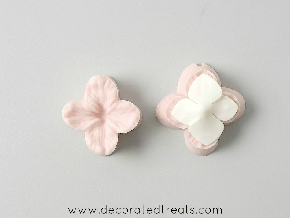 Silicone hydrangea formers with a gum paste hydrangea flower on