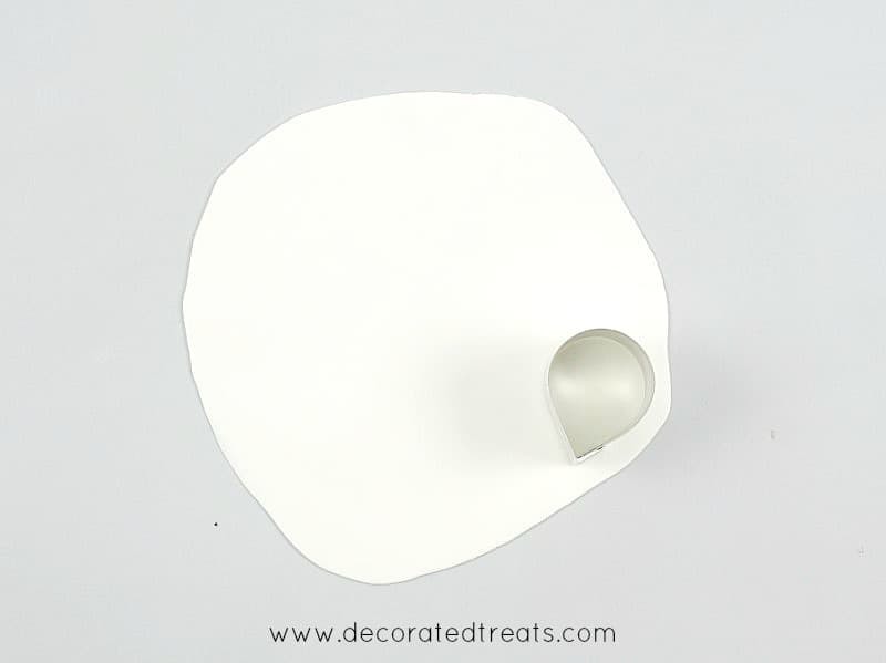 Using a petal cutter to cut a petal on a thin rolled gum paste