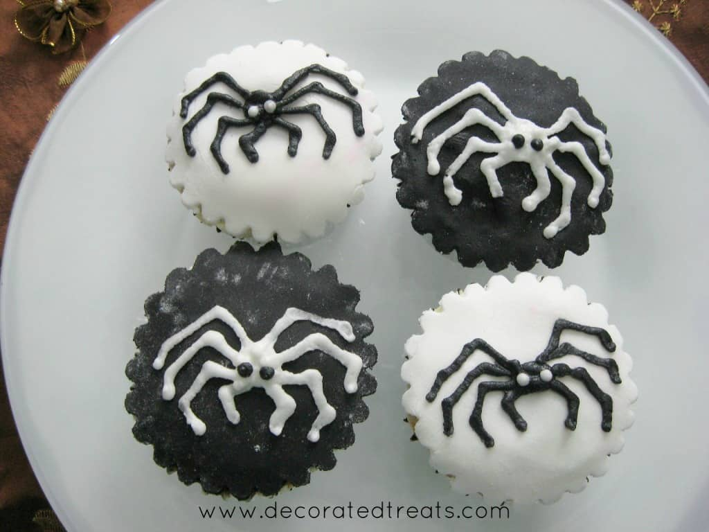 Black and white cupcakes with spiders design