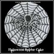 A royal icing spider motif on a cake