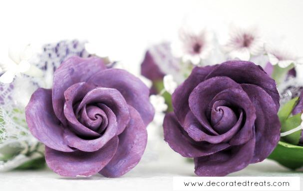Purple gum paste roses in a bouquet
