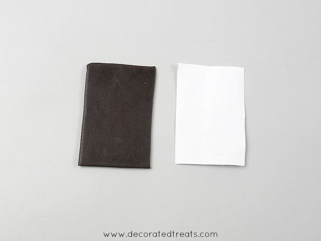 A paper template and a rolled and cut brown fondant