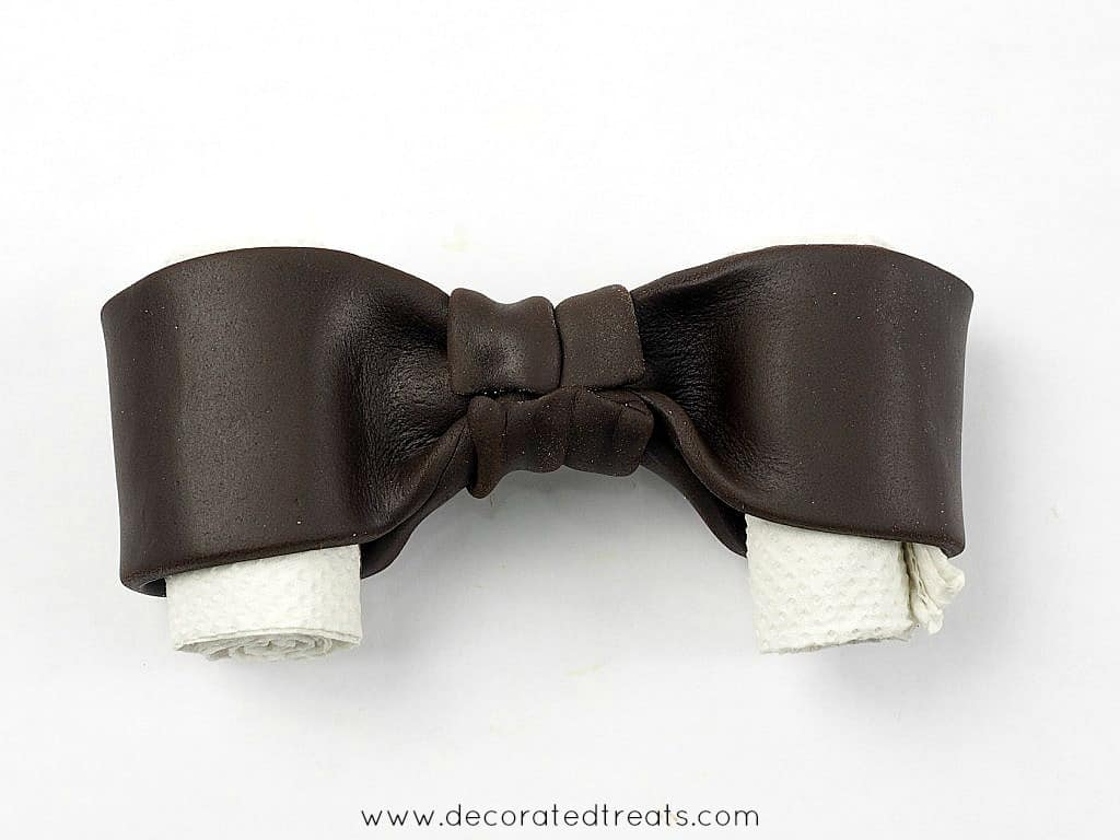 The rear side of a fondant bow