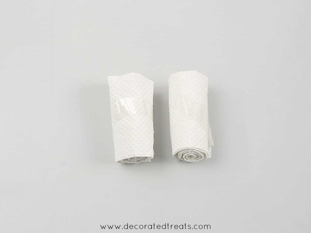 2 rolls of tissue - side view