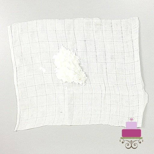 A square piece of white cloth with some cornstarch in the center