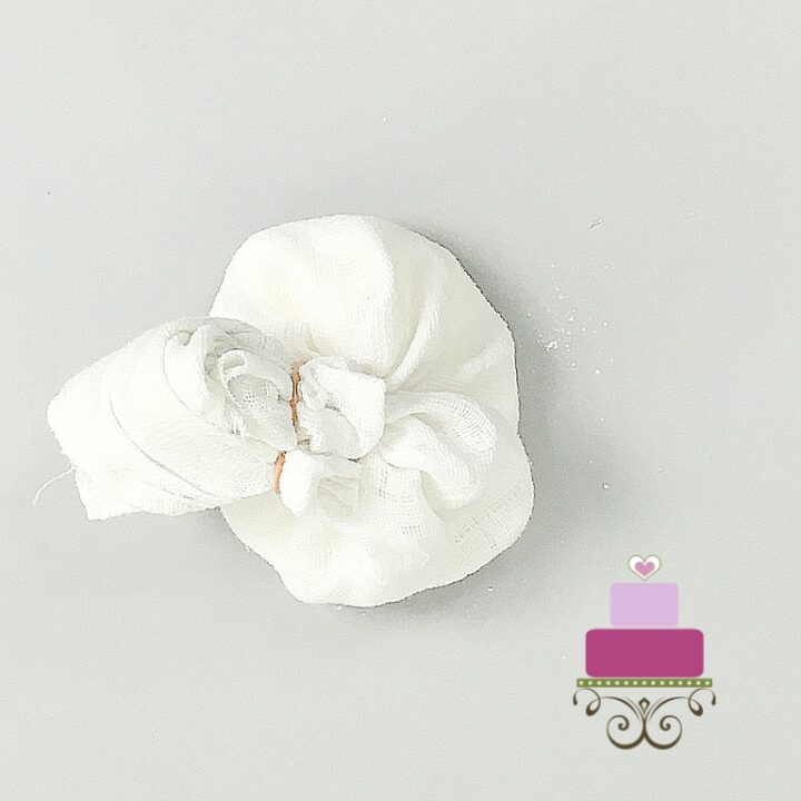 Top view of a fondant dusting bag made using white cloth