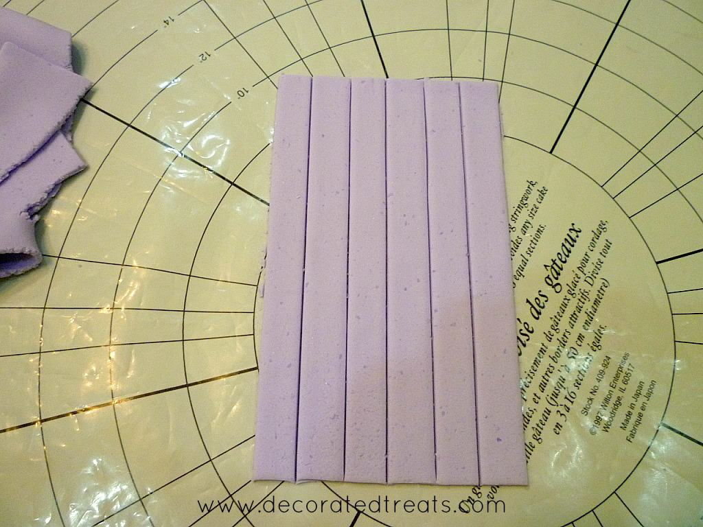 Violet fondant cut into strips