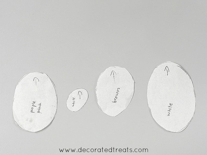 Paper templates cut into different sized ovals