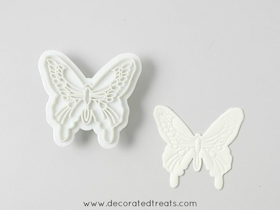 A gum paste butterfly cut out and a butterfly cutter