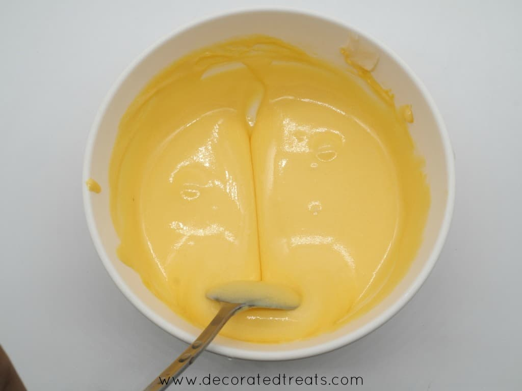 Yellow icing in a bowl