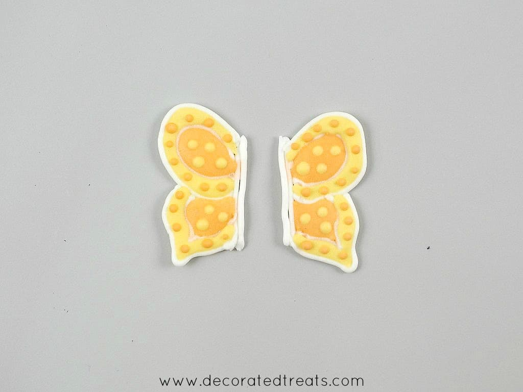 2 wings of a royal icing butterfly, not attached together