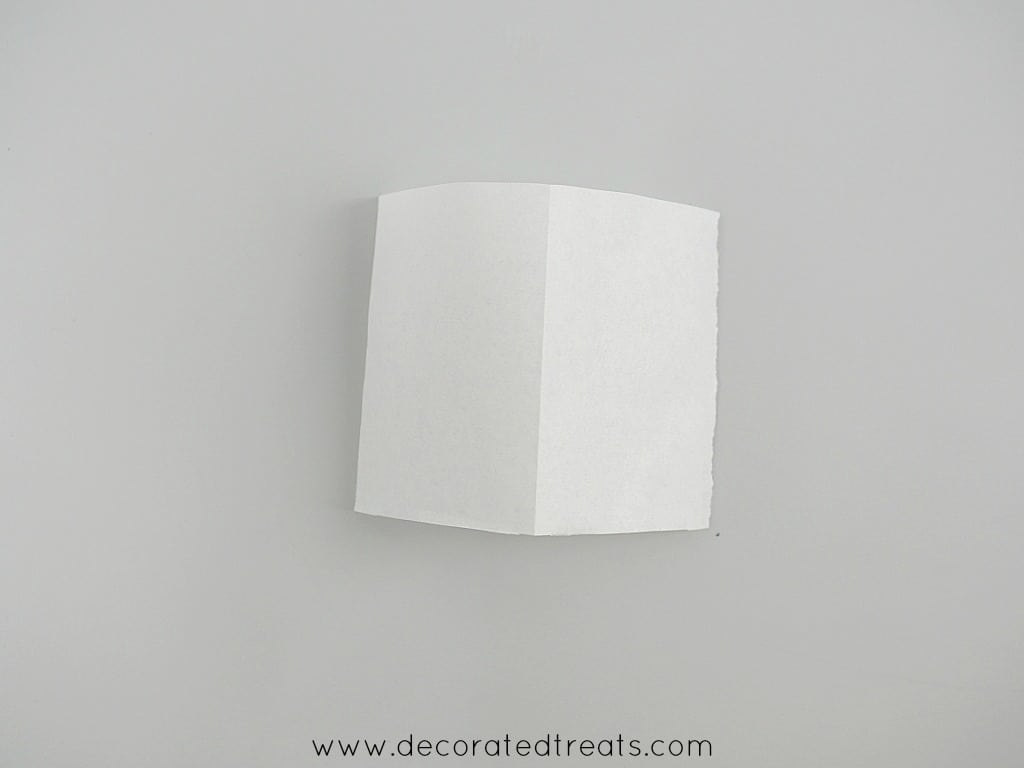 Paper folded into 2