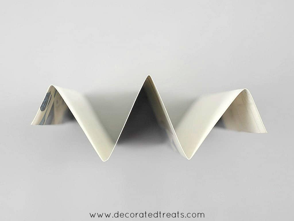 W folded paper