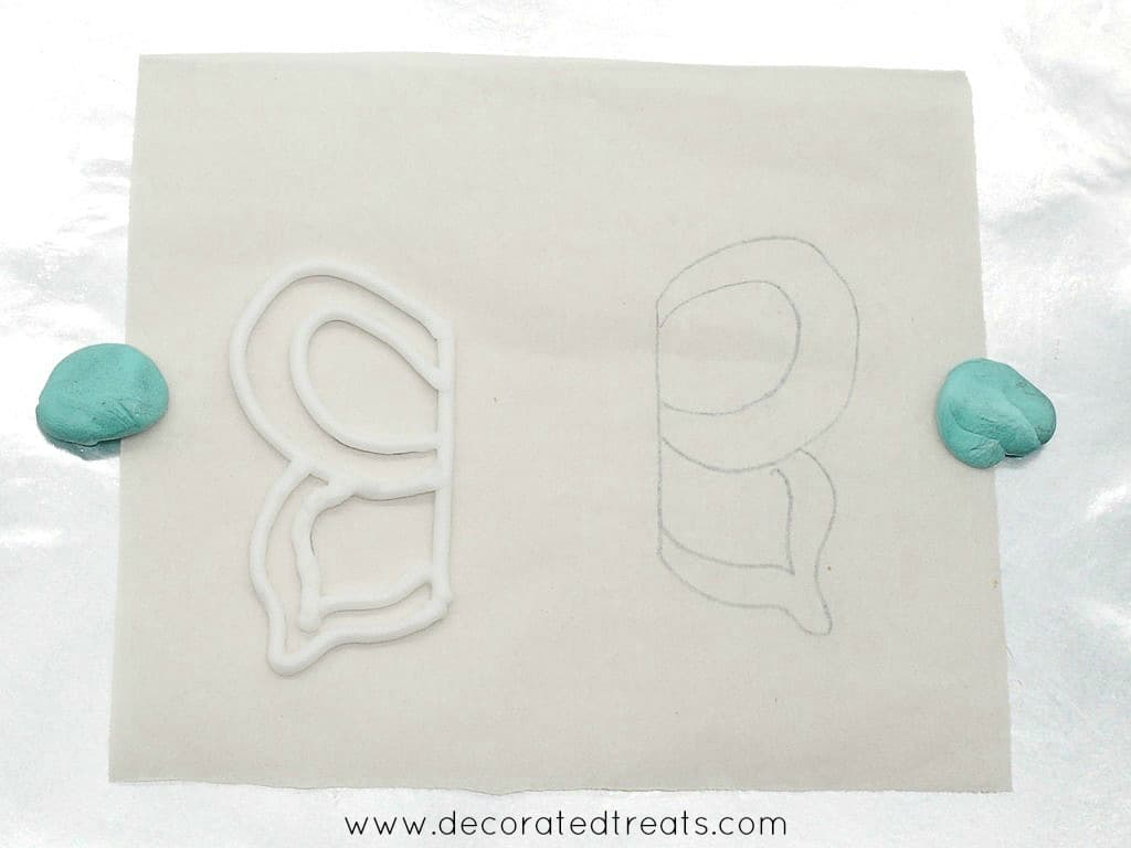 White outline of a royal icing butterfly