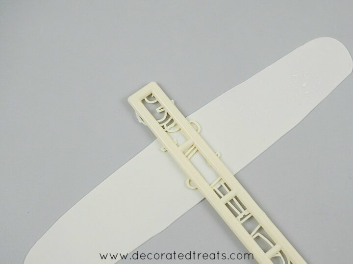 Tappit letter cutter on a long piece of gum paste strip