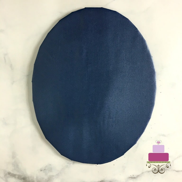A brown cake board DIY wrapped in blue paper