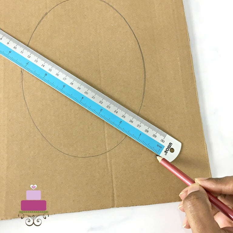 Marking a cardboard with pencil and ruler