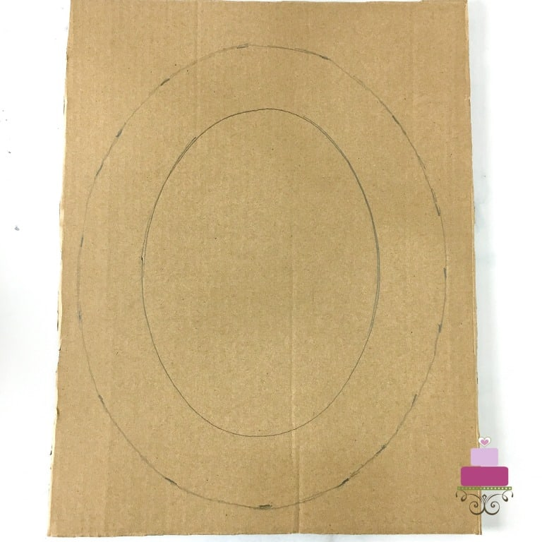 An oval template drawing on a brown cardboard