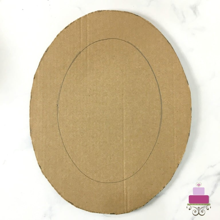An oval shaped cardboard cutout