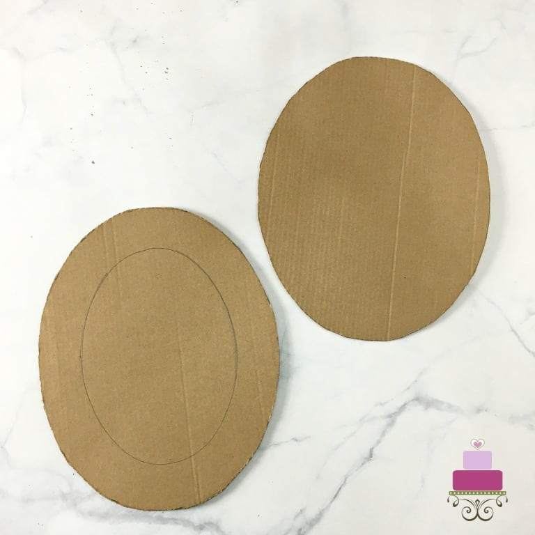 2 oval shaped brown cardboard cutouts